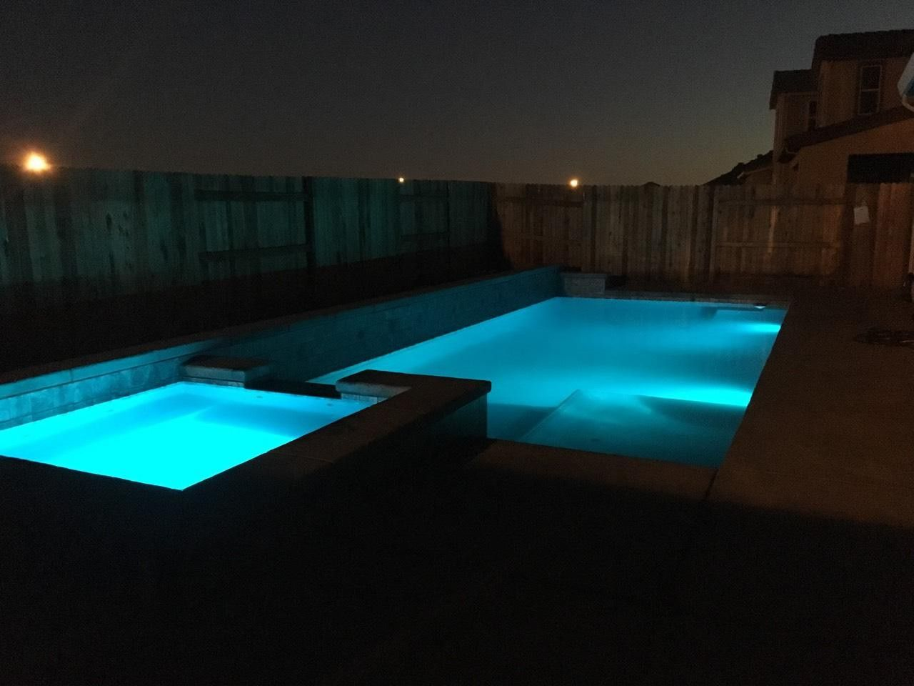 Swimming Pool And Spa With Color Led Lights At Night