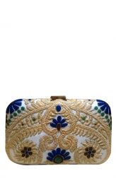 Unique and beautiful embellished clutch made from white raw silk and adorned with intricate hand embroidery crafted from gold, blue and green thread. With a subtle clasp at the top, this clutch is a statement making piece which can be matched with traditional wear and used for special and festive occasions.