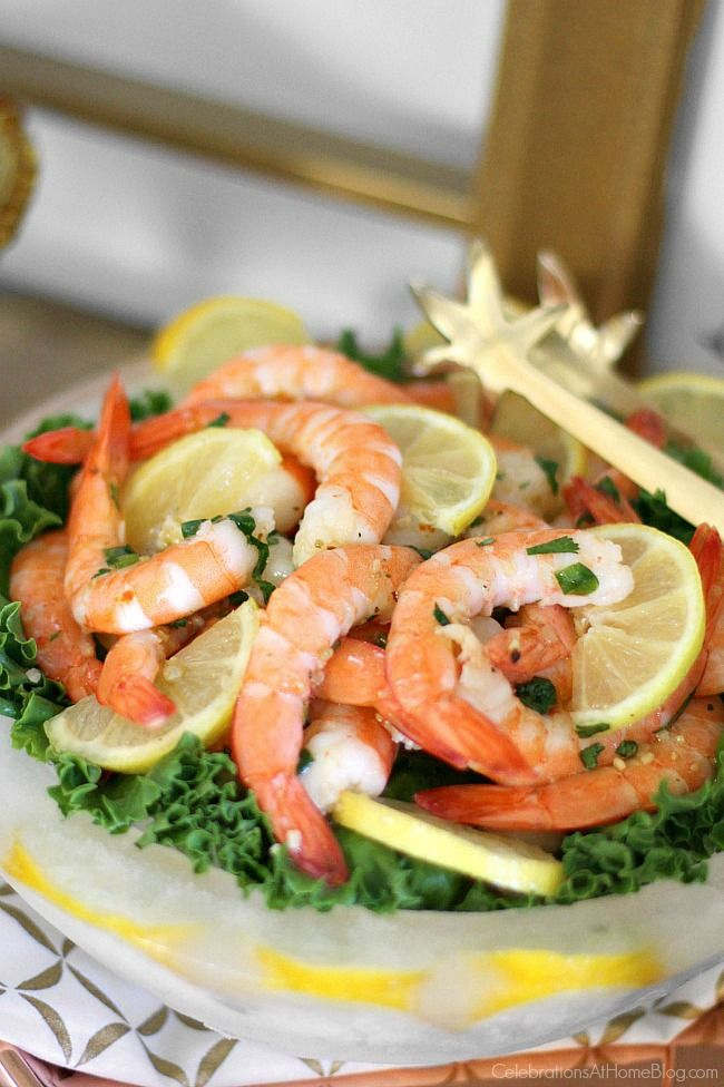 Take a classic appetizer to the next level with this marinated shrimp cocktail recipe served in an ice bowl.