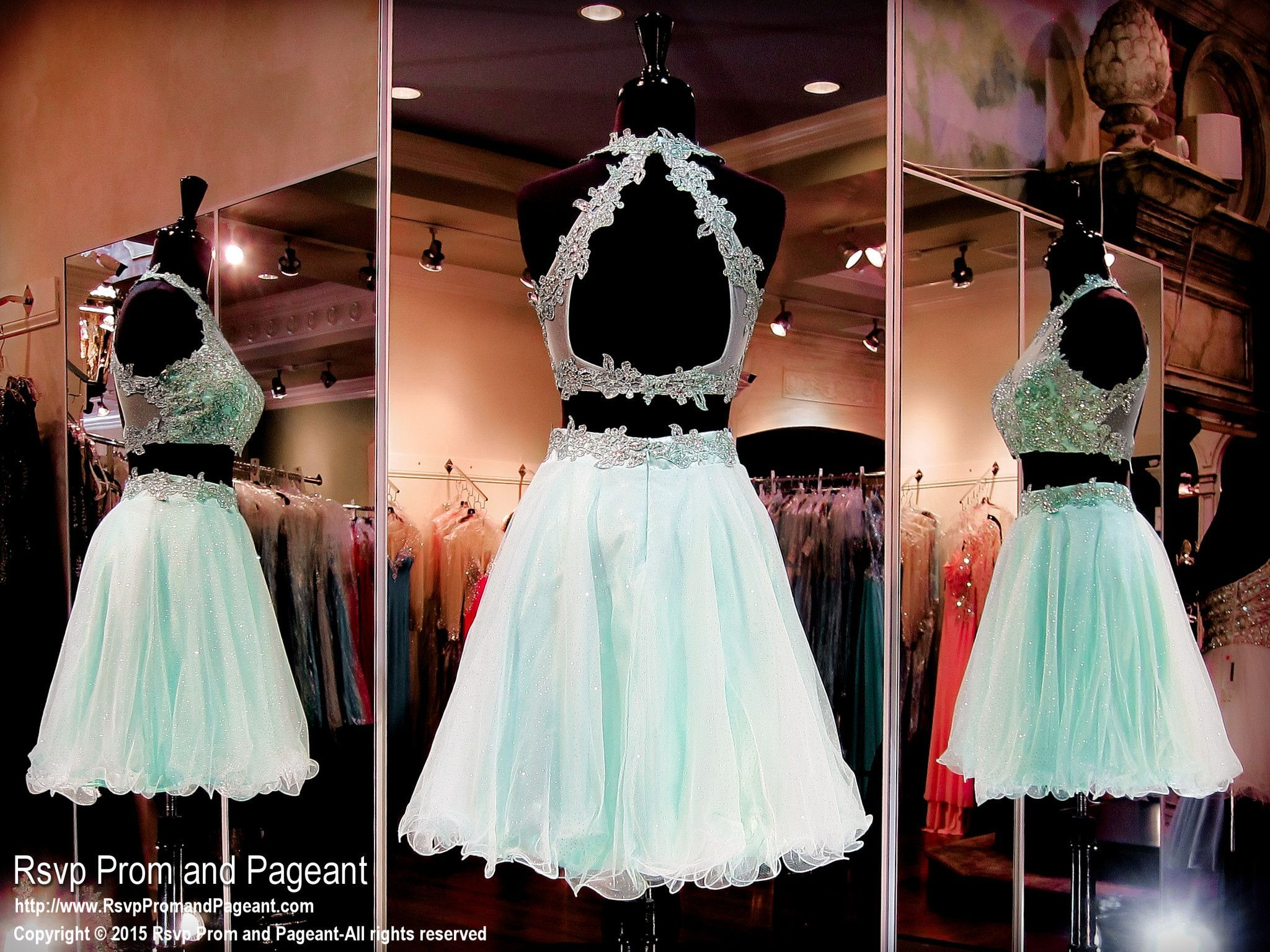 What a fabulous two piece short dress! Lace embellishments adorn its high neckline crop top with open back and full tulle skirt. So cute and it's at Rsvp Prom and Pageant, your Atlanta Prom Store!