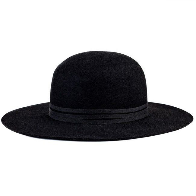 cb97d2744 The Magdalena is a stiff wide brim round top felt hat with three ...
