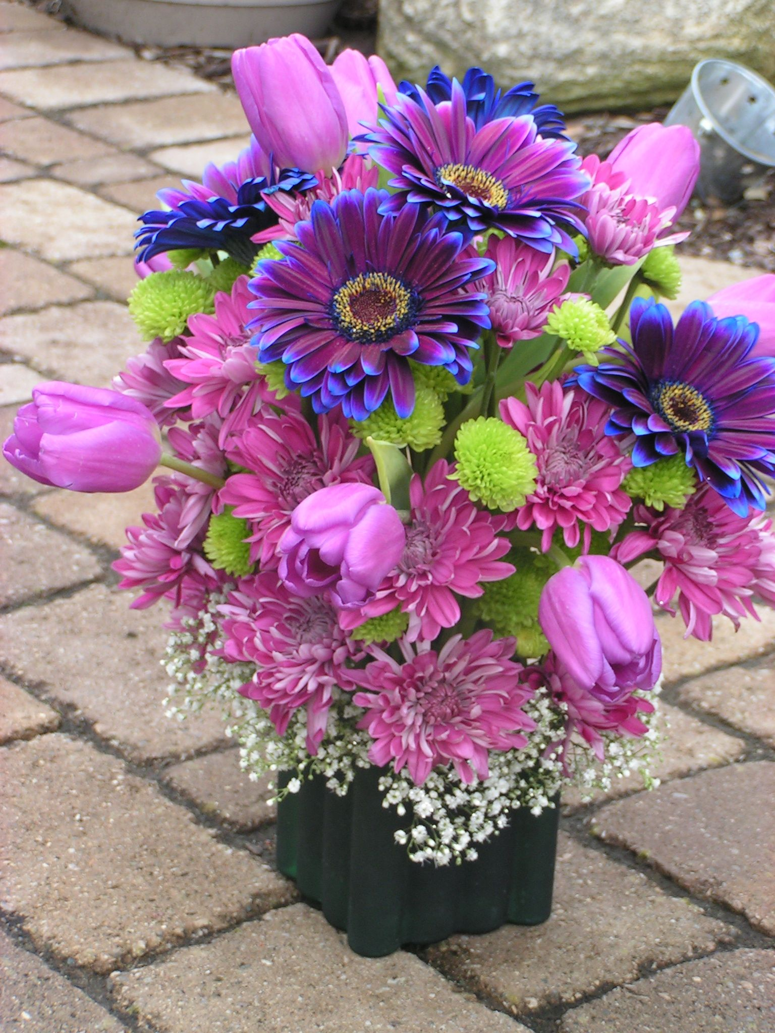 Centerpiece - Purple and Blue Gerber Daisies, with purple tulips and ...