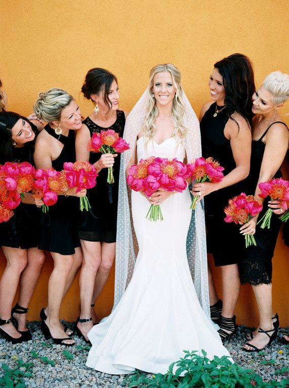 Black bridesmaid dress love the bright colored flowers for Bright colored wedding dresses