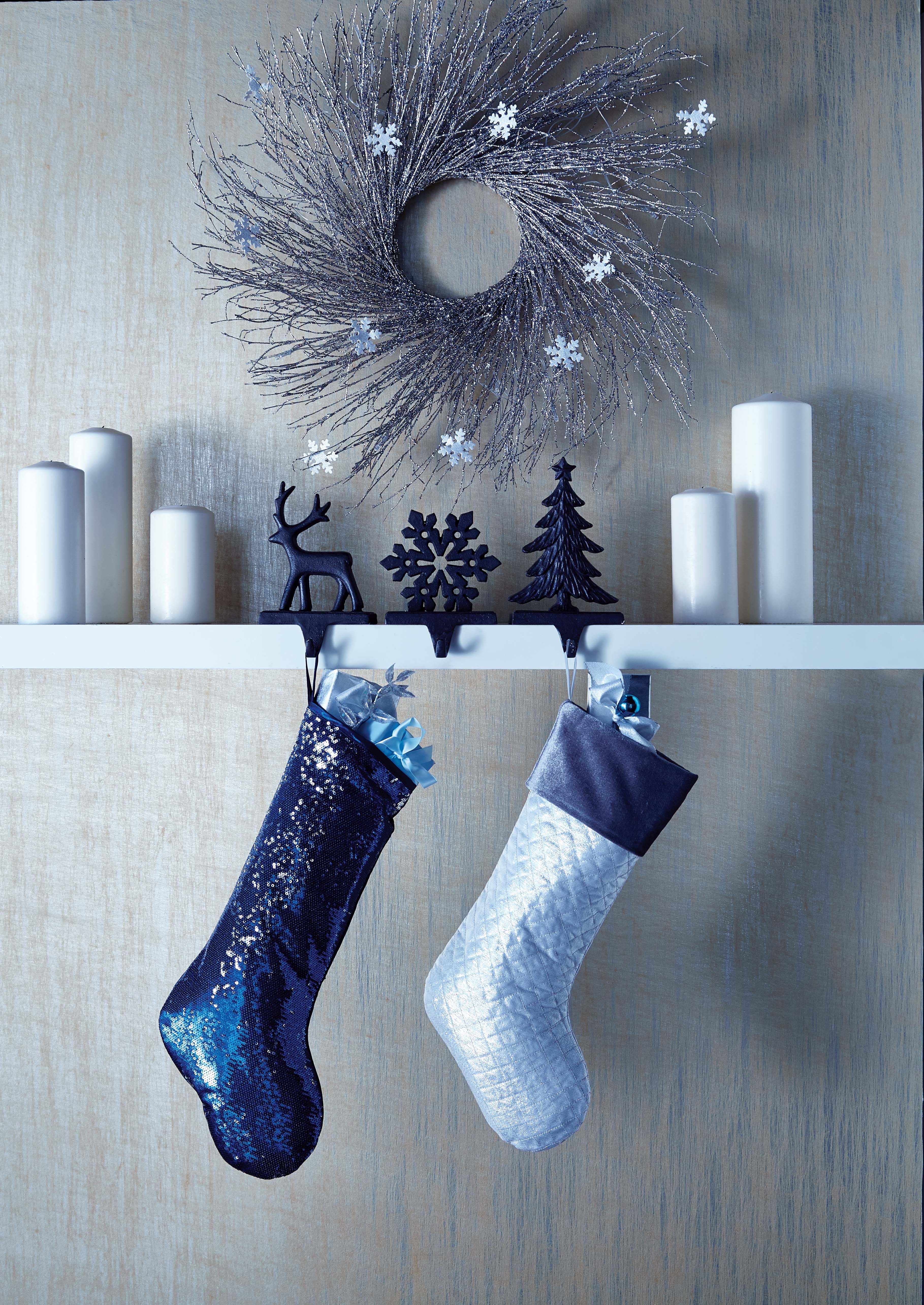 Mix white, blue, and silver for a statement-making mantle
