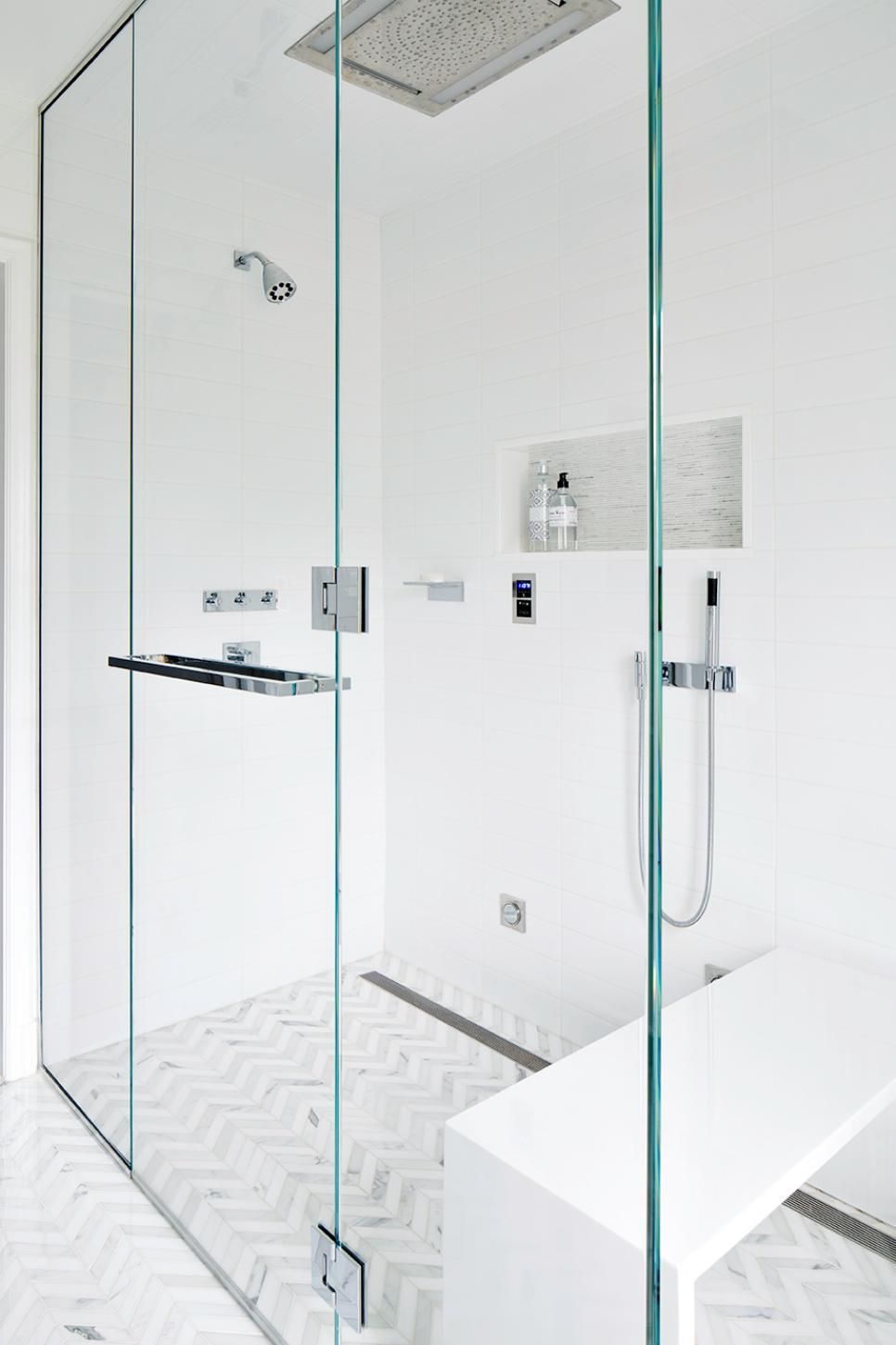 spacious all white bathroom. An All-white Contemporary Master Bathroom Features A Spacious Glass Shower With White Bench For Added Comfort. All S