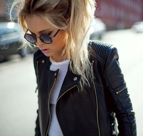 Love the leather jacket and messy pony tail combo here!