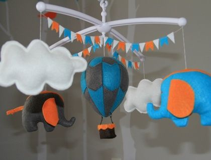 With MUSICAL CRIB ATTACHMENT. Circus themed turquoise blue, grey and orange hot air balloon and elephant babies mobile. Ready to ship.