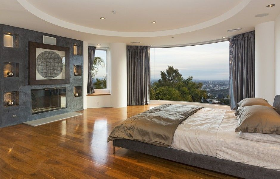 incredible hardwood floor bedroom   This master suite has a huge floor to ceiling window that ...