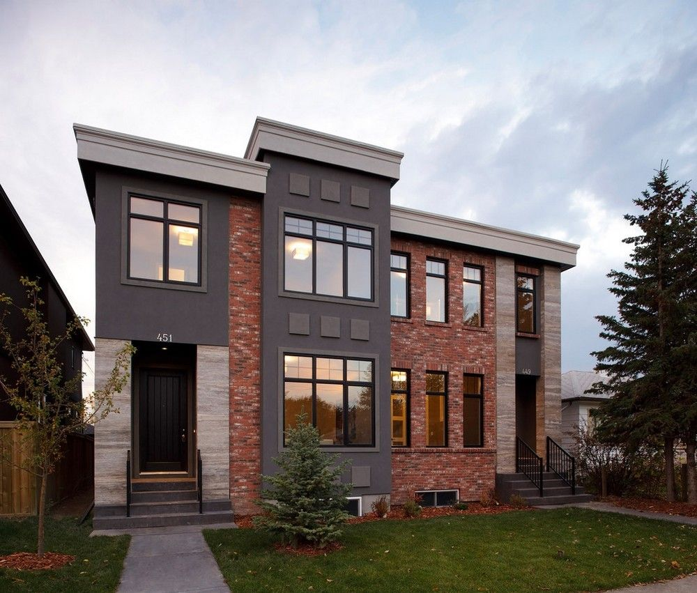combination of red brick and gray stucco in the exterior | house