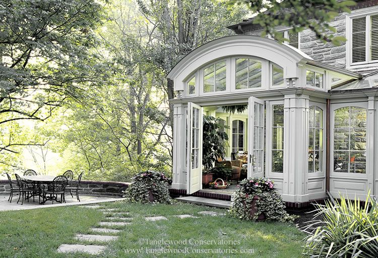 A glass conservatory sunroom a unique process of for Glass house additions