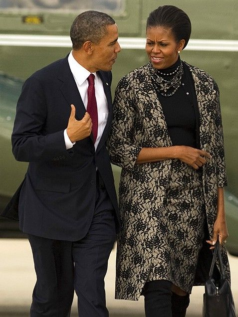 All Laced Up  Before hopping aboard Air Force One for a trip to Hawaii, Australia and Indonesia; Mrs. Obama and the President spent Veterans Day at Arlington National Ceremony placing a wreath at the Tomb of the Unknowns. Looking sophisticated and feminine, the First Lady accented a lace-print skirt suit and black turtleneck with an assortment of necklaces.