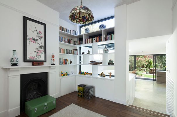 See-through shelves. Favorite finds provide subtle screening in wide, open-back shelves. This is a good example of adding a wall that isn't a wall; the structure creates a cozy corner that borrows light and views from the rest of the house.