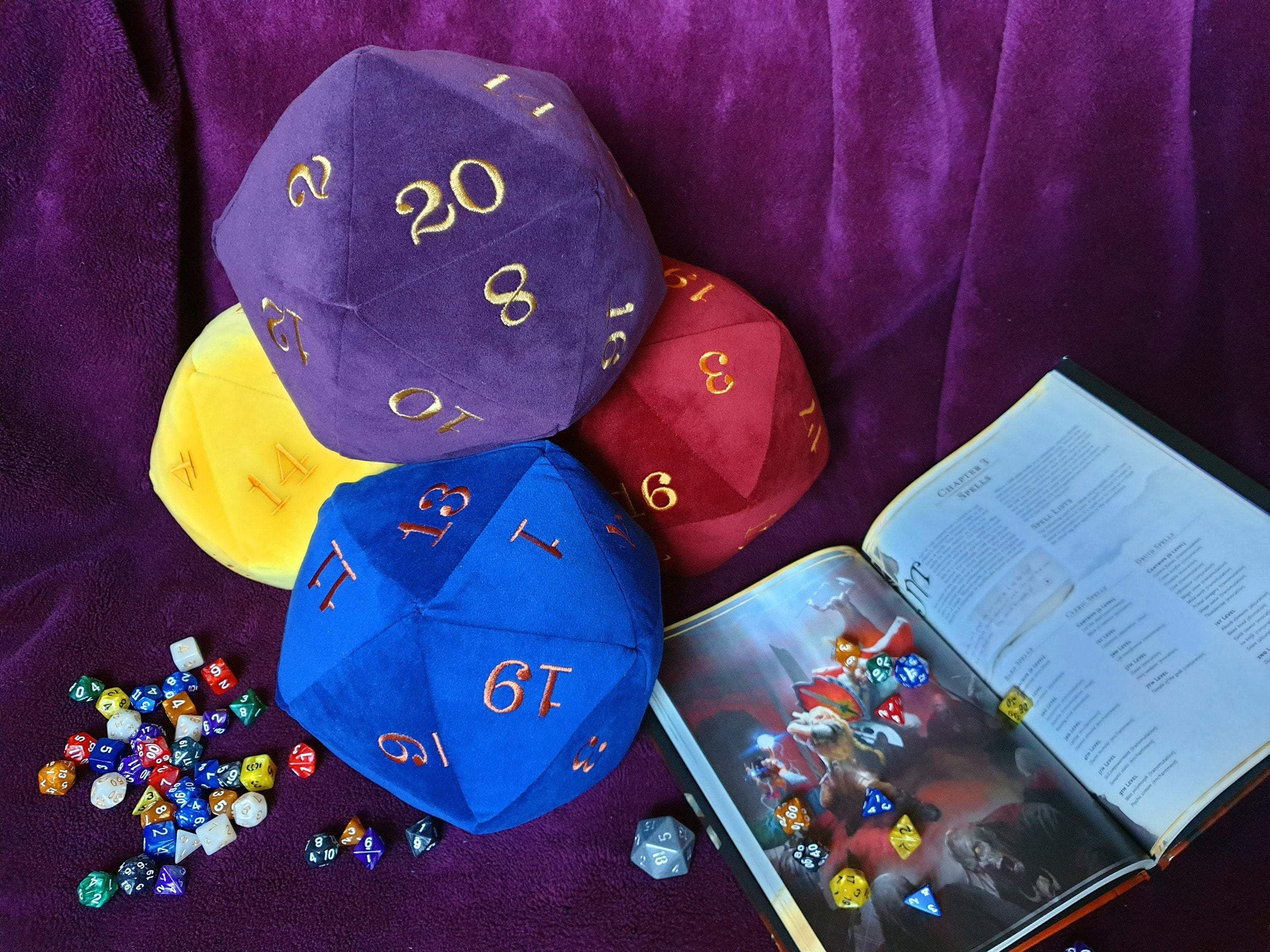 Plushie Purple Giant D20 made up in a Deluxe Velvet in a Deep Grape Purple Colour and Machine Embroidered with Metallic Gold Numbers
