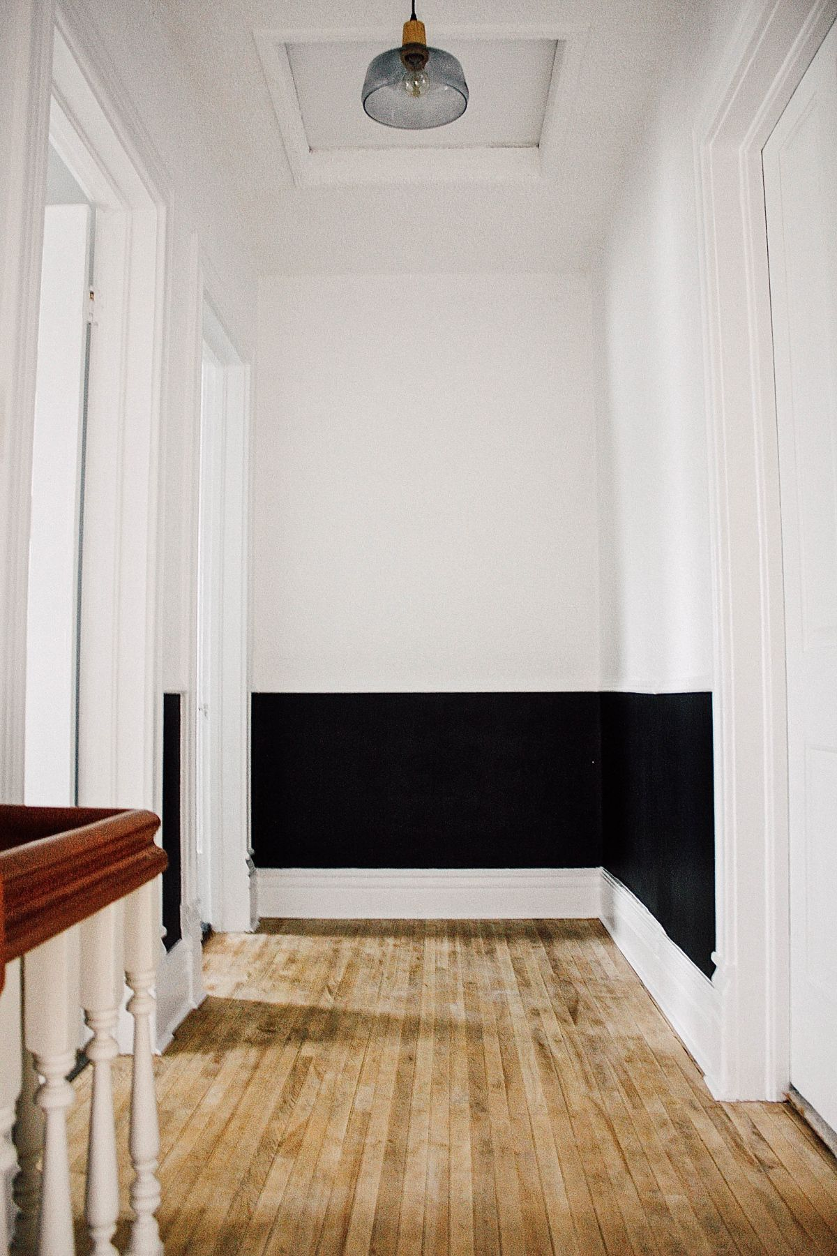 White and black walls, chair rail, hardwood floors, vintage-inspired ...