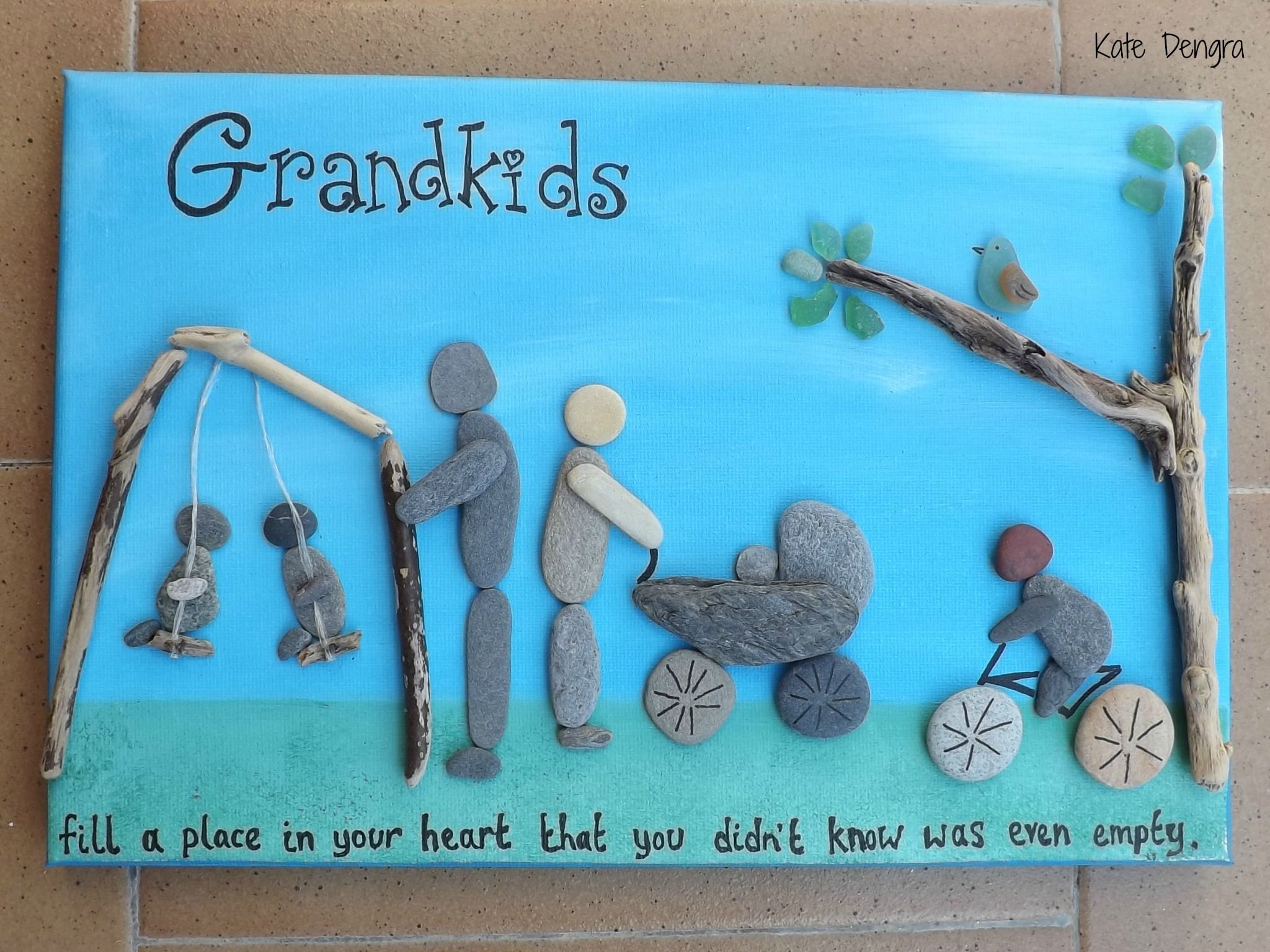Customised with any family members and activities. Grandkids or Parents, Grandparents, pets whatever....you name it I will recreate it (by Kate Dengra). Pebble art made with sea sticks and stones