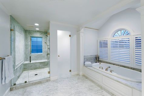 The Carrara marble-clad #master #bathroom inside the Dorgan\'s home ...