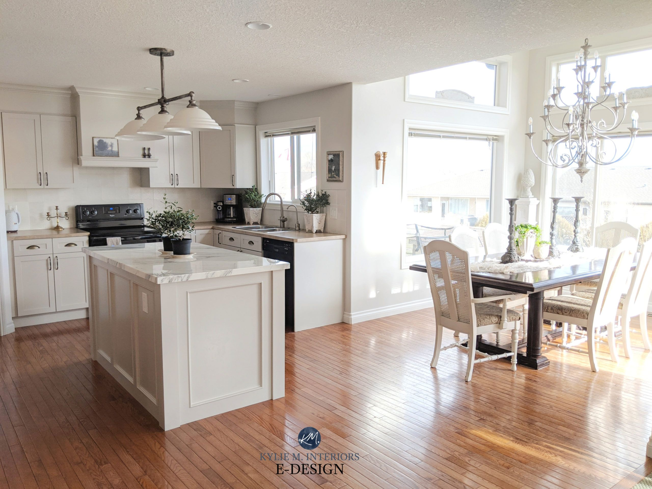 Open layout living and dining, painted wood cabinets ...