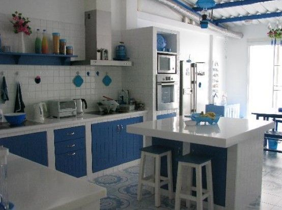 Masonry kitchens with built-in stone or cement shelves and cement sinks.