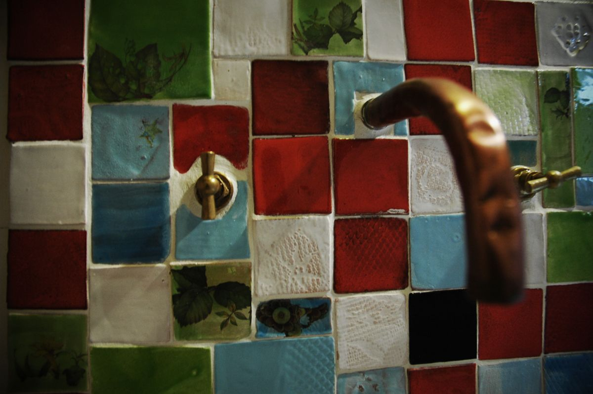 Handmade tiles in bathroom, over sink at laCultura B&B and CasaRural Cútar, Axarquia, Malaga.