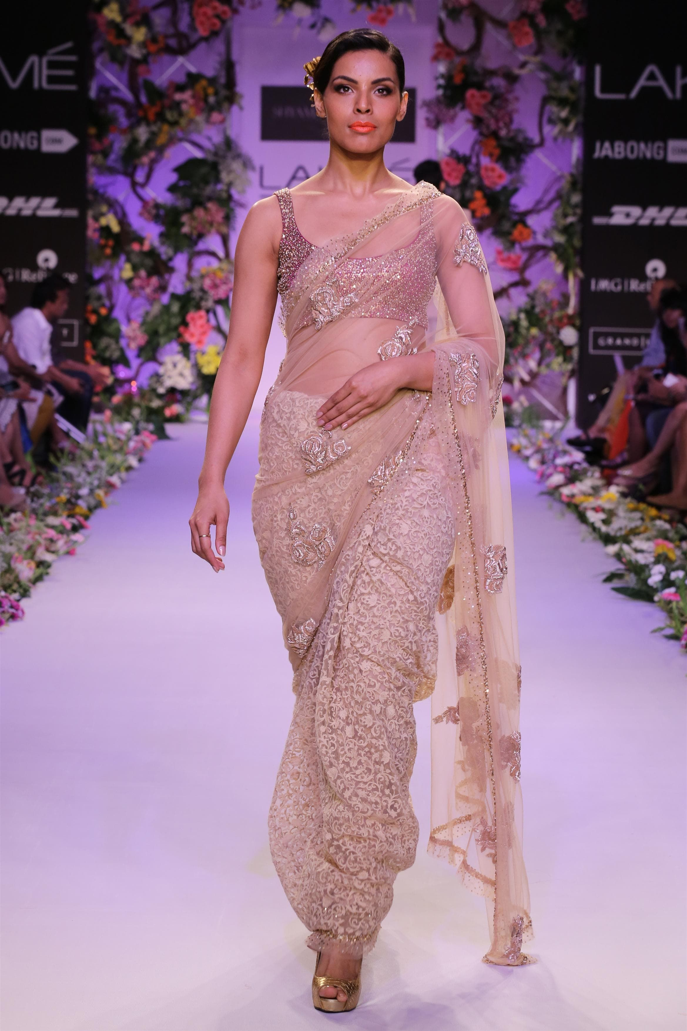 A beige half/half tulle saree with a woven pleat fabric and a tulle ...