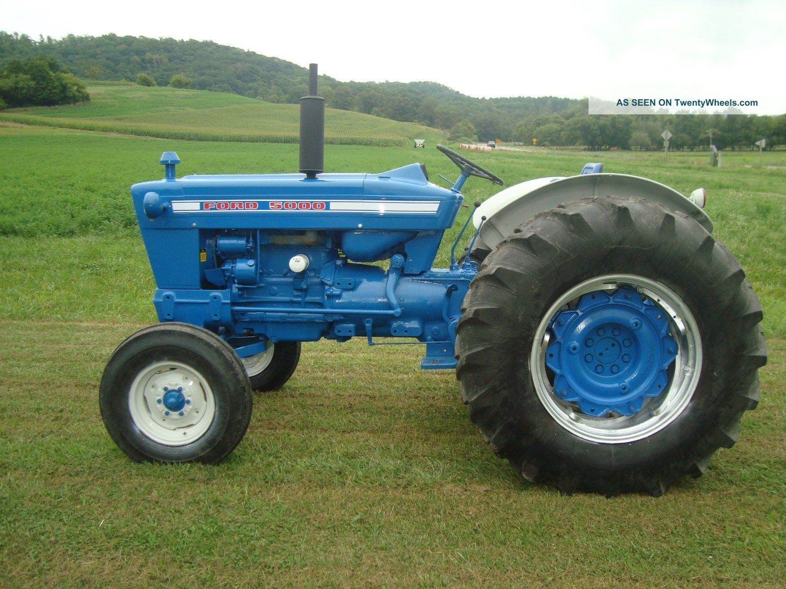 The ford 5000 was a blue and white tractor in production for Ford motor company description