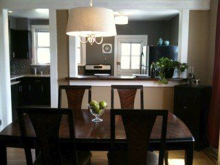 Created Opening Breakfast Bar Between Kitchen And Dining Room