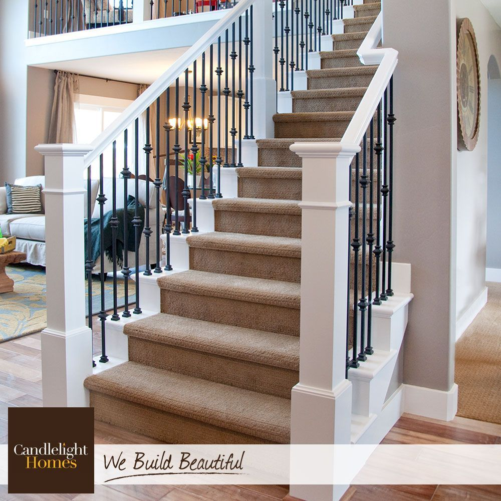 White Wood Railings And Wrought Iron Spindles Create The Perfect Contrast For Basement Stairs Storage In 2019 Wrought Iron Stair Railing Staircase Makeover Iron Stair Railing