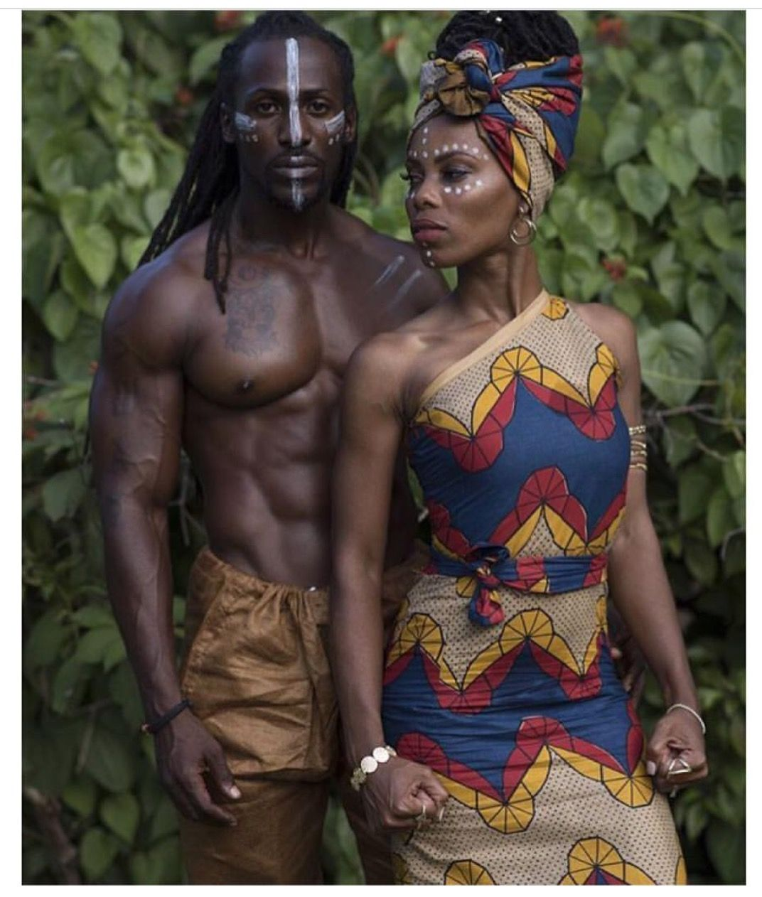 Regal tribal paint & Kenté & other African fabrics. #prints #fabric #AfricanFabric #fashion #style