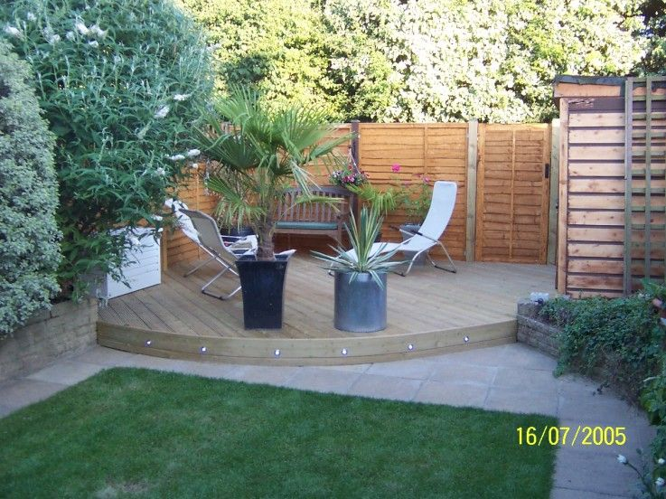 Pine decking for the corner of a small garden backyard for Garden decking ideas uk