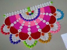 Very innovative and multicolored rangoli design by DEEPIKA PANT