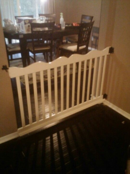 Side of crib repurposed as baby gate. Just attach hinges ...