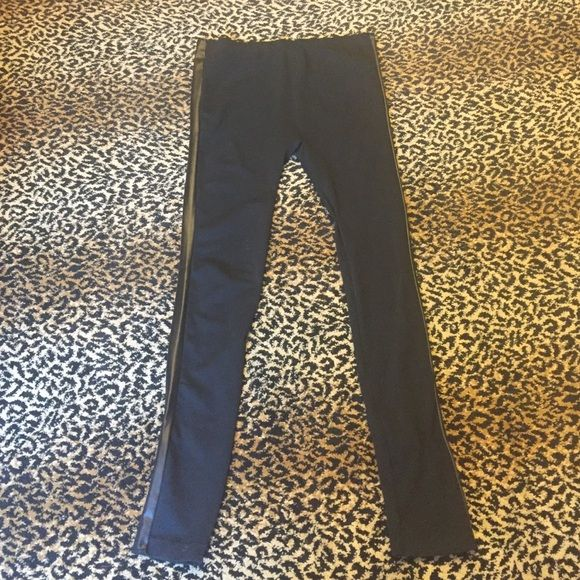 Black Tuxedo Leggings These leggings are super stretchy for ultra comfort.. No binding around the waist so absolutely no muffin top!! Cool black pleather strip down the side of each leg. Size M/L. Did I mention ultra comfy!?? Pants Leggings