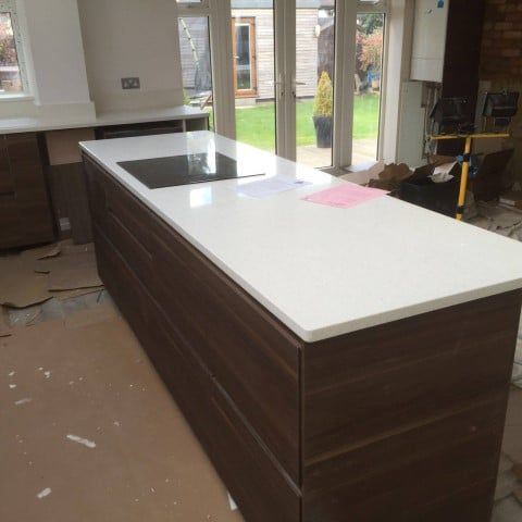 The Bianco Stella Is Features In This Wooden Style Kitchen The White Of The Quartz Matches Perfectly Against The Granite Colors Brown Kitchens Kitchen Styling