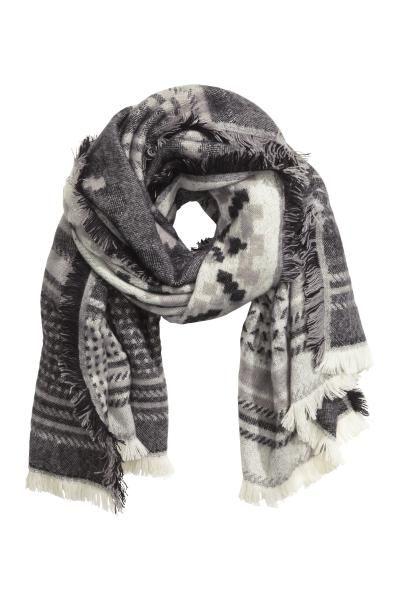 Jacquardgeweven sjaal: Een jacquardgeweven sjaal met franje rondom. Afmetingen 85x180 cm.