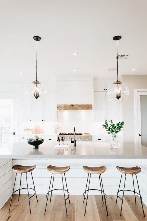 Bright White Kitchen With Wooden Bar Stools Modern Home