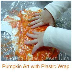 No Mess Pumpkin Art with Free Printable #creativeartsfor2-3yearolds Do you have a child who doesn't like to get paint on the hands? Try this pumpkin art with plastic wrap! A fun fall activity for toddlers and preschoolers from Teaching 2 and 3 Year Olds #creativeartsfor2-3yearolds
