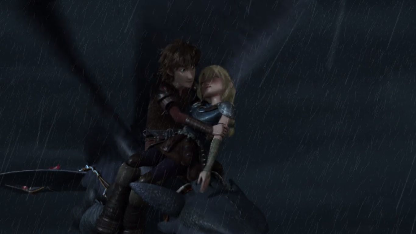 Hiccup holding Astrid in his arms after he saved her from drowning