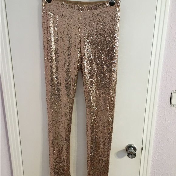 Gianni Bini, Rose gold sequin leggings. New without tag, Gianni Bini rose gold sequin leggings. Size Large. Waist measures 15inches laying flat with an extra 5inch stretch. Legs have a small amount of stretch. Smoke free home. Make me an offer :) Gianni Bini Pants Leggings