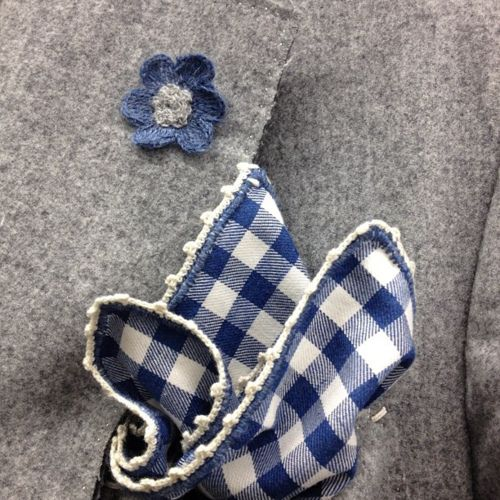 interesting blue-white checked pocket square and boutonniere on grey flannel