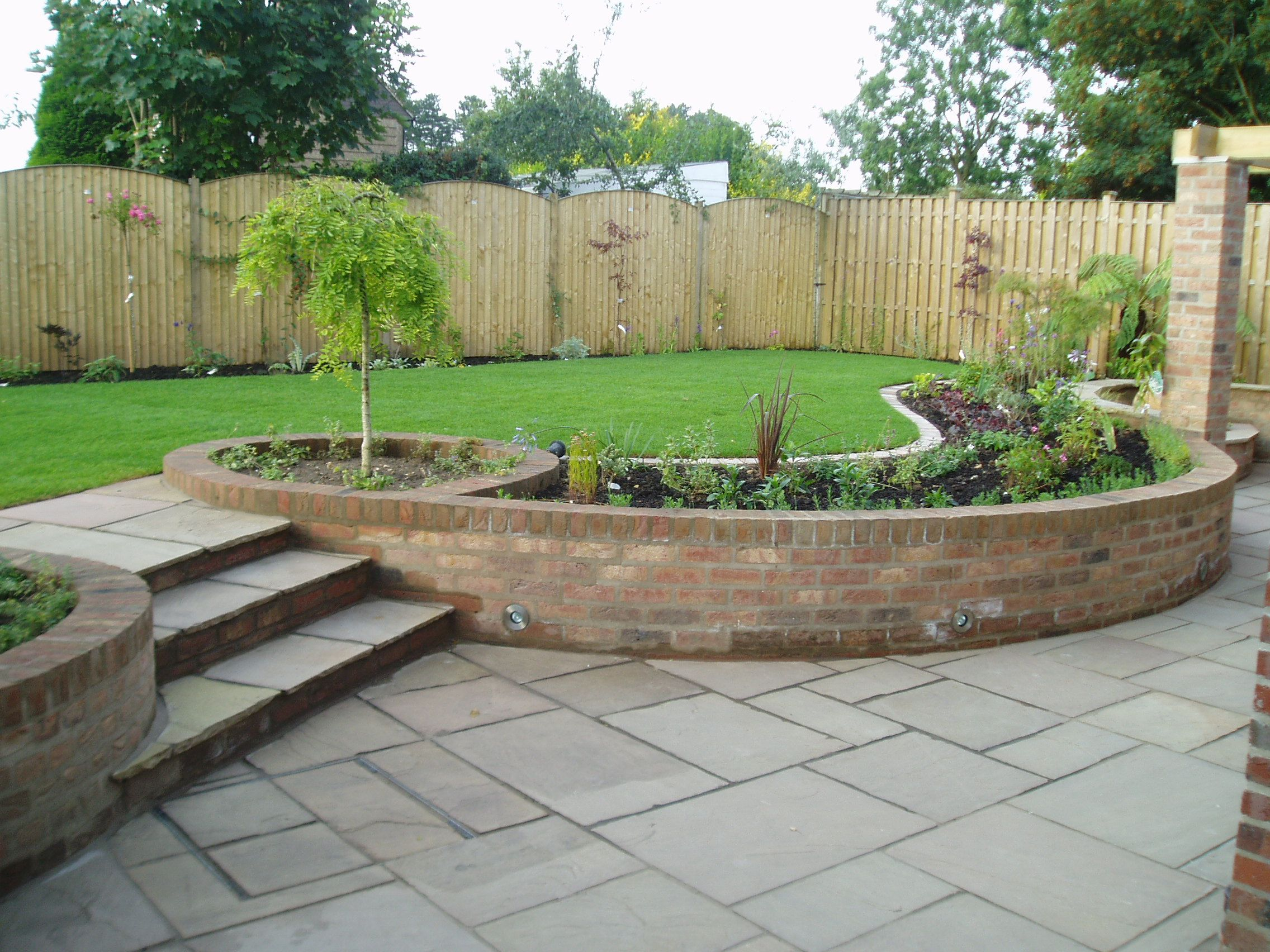 One of our split level gardens in South Milford … | Sloped ... on Split Garden Ideas id=19440