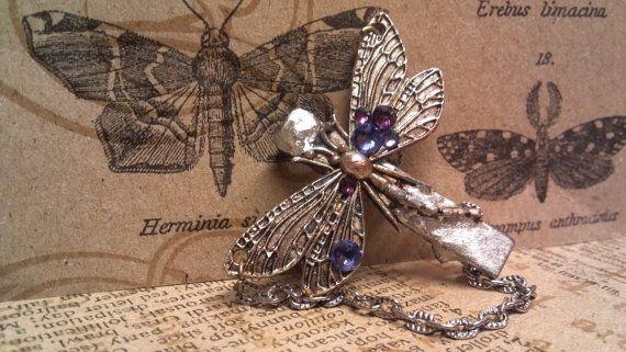 http://www.etsy.com/listing/122702688/captive-dragonfly-steampunk-hair-clip