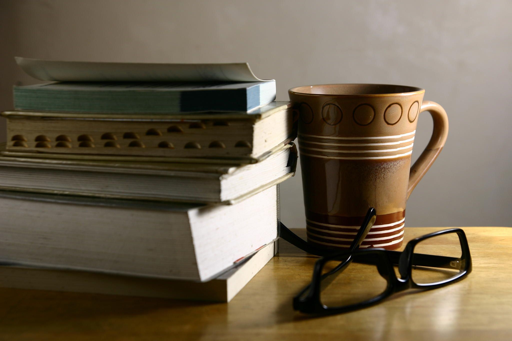 Photo of a pair of eyeglasses old books and a coffee mug on a eyeglasses books and coffee mug photo of a pair of eyeglasses old books and a coffee mug on a wooden table geotapseo Gallery