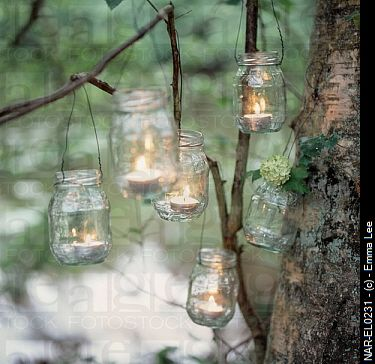 Recycled Glass Jam Jars Reused As Candle Holders Hanging From Tree