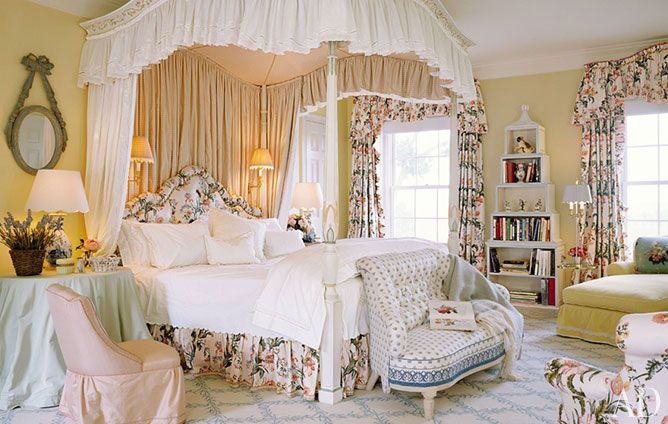 In the master bedroom of a Virginia house by architect Tommy Beach Jr., Buatta installed one of his signature hand-carved and painted canopy beds.