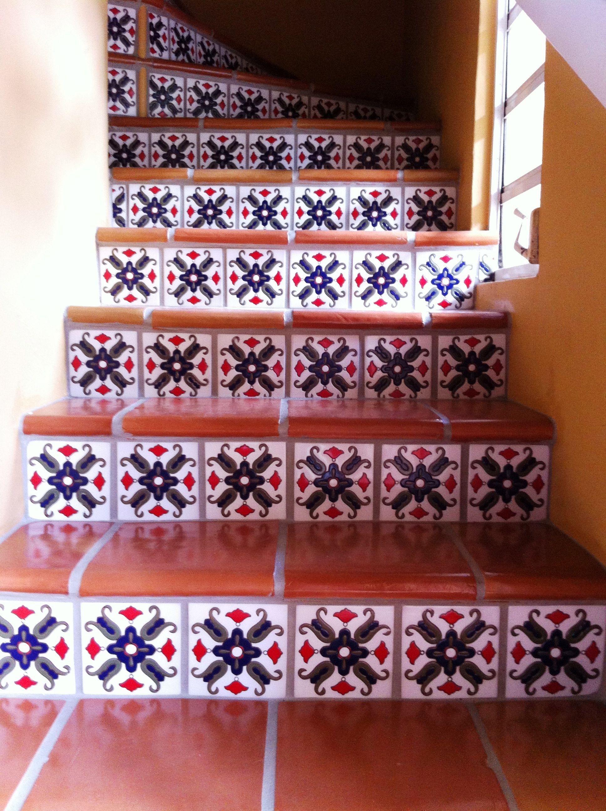 Saltillo terracotta spiral stairway with talavera stair risers view our talavera mexican painted ceramic clay tile mural tiles talavera sinks and accessories wholesale mexican tile prices in the tile industry doublecrazyfo Image collections