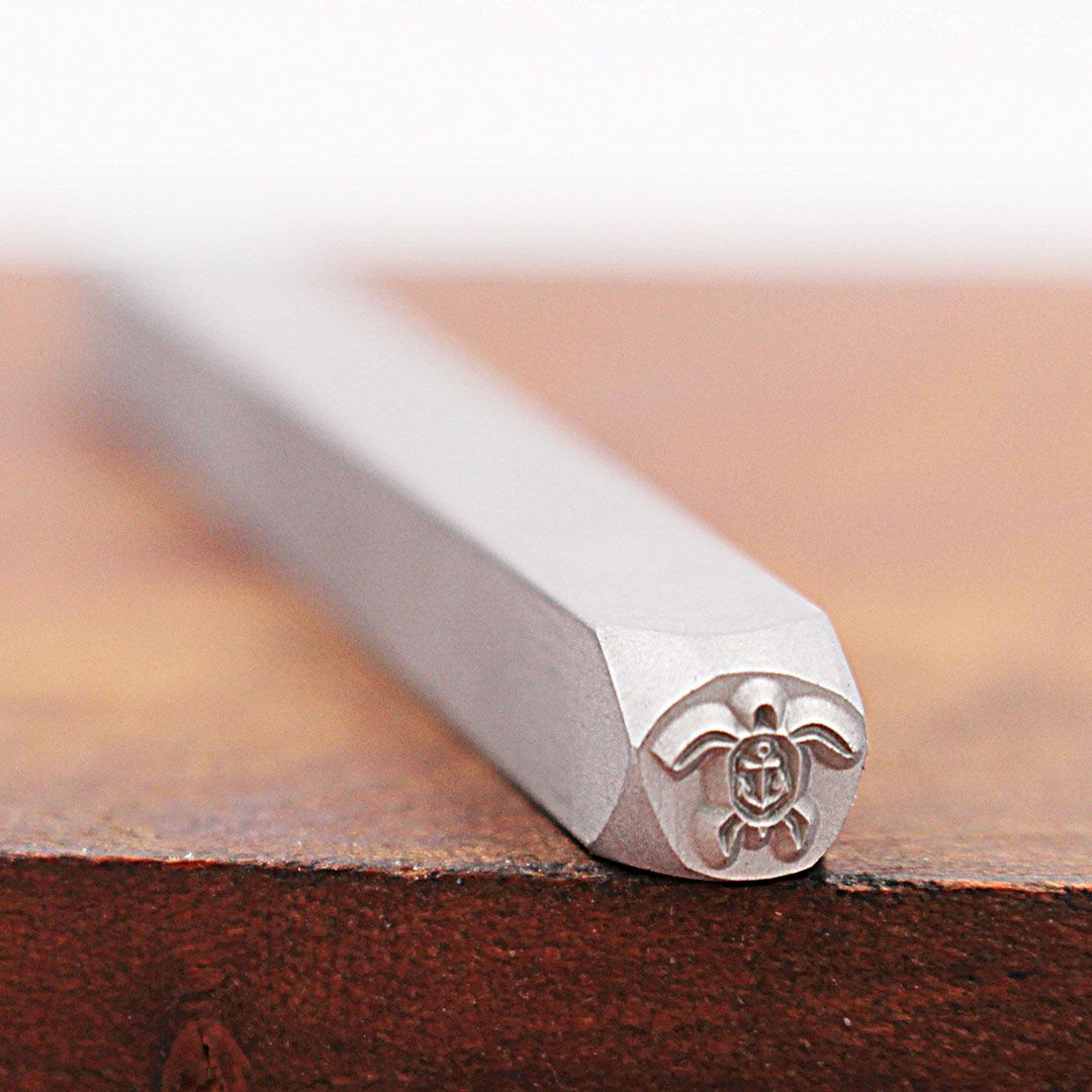 This custom stamp for marking metal is smaller than a penny! For