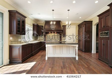 Dark Wood Cabinets With White Island Luxury Kitchen