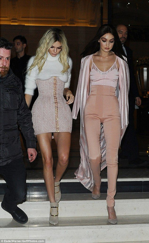Leggy looks: Kendall made the most of her long legs in a thigh-skimming mini while Gigi highlighted her slender figure in a pair of high-waisted peach trousers