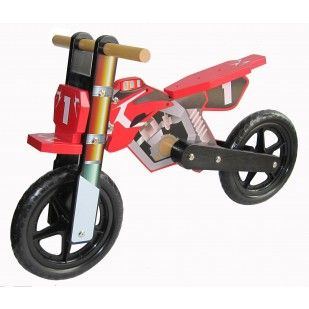 Children's Motorbike Wooden Balance Bike. This balance bike is ideal for young children learning to ride. It allows them to concentrate on the basics of balancing first. The motorbike design is ideal for any young child.