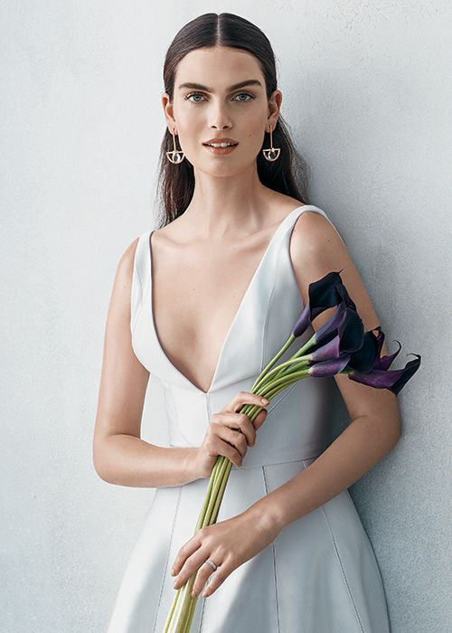 f1f122954b 6 Chic White Dresses for All Your Pre-Wedding Parties   6. Go Deep -  Rehearsal dinner alert! A rich fabric and sweet silhouette keep a deep-V  wearer from ...